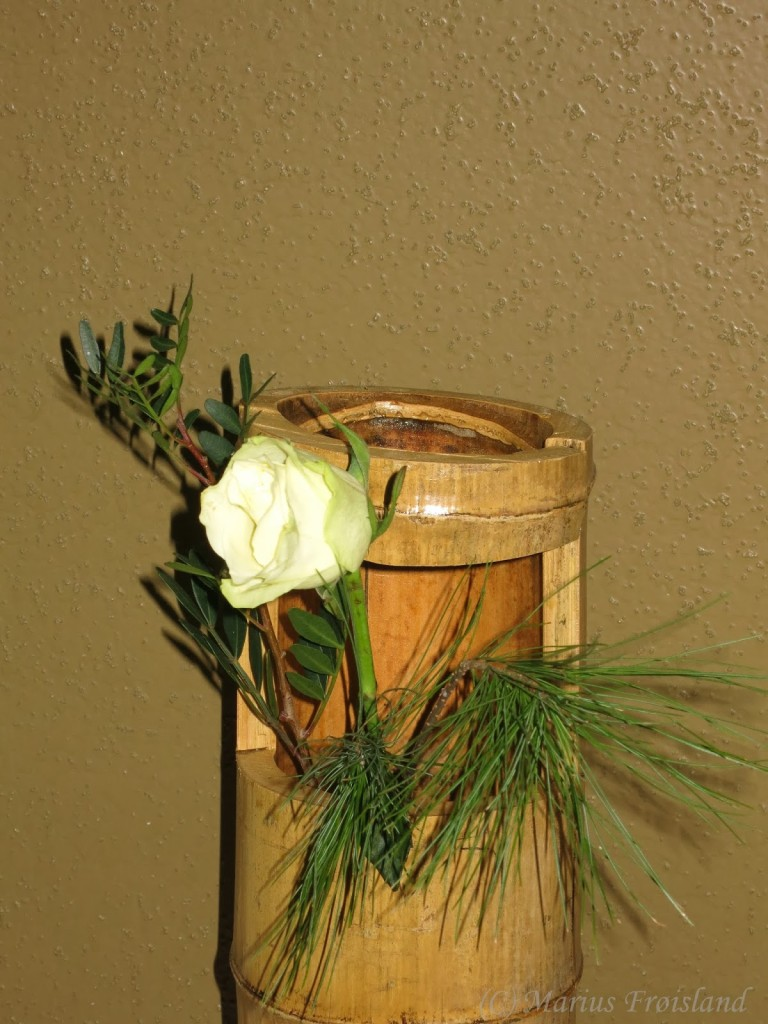 Flowers arranged in a vase I made from bamboo supplied by one of the guests.